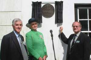 Following his speech, Lord Buckinghamshire unveils the plaque with Lady Mary Holborow and Parish Council Chairman Peter Hardaker